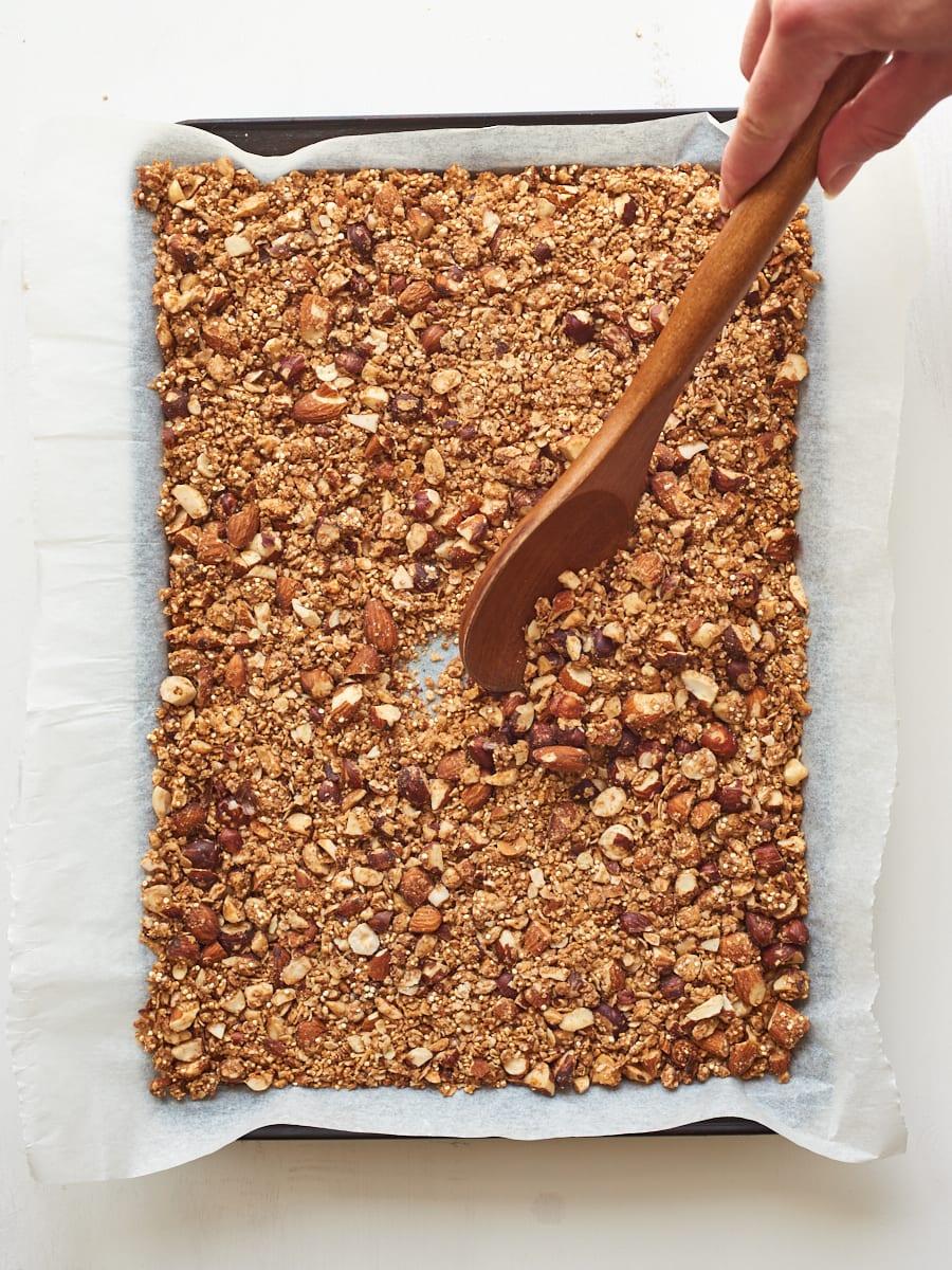 Mixing granola in pan