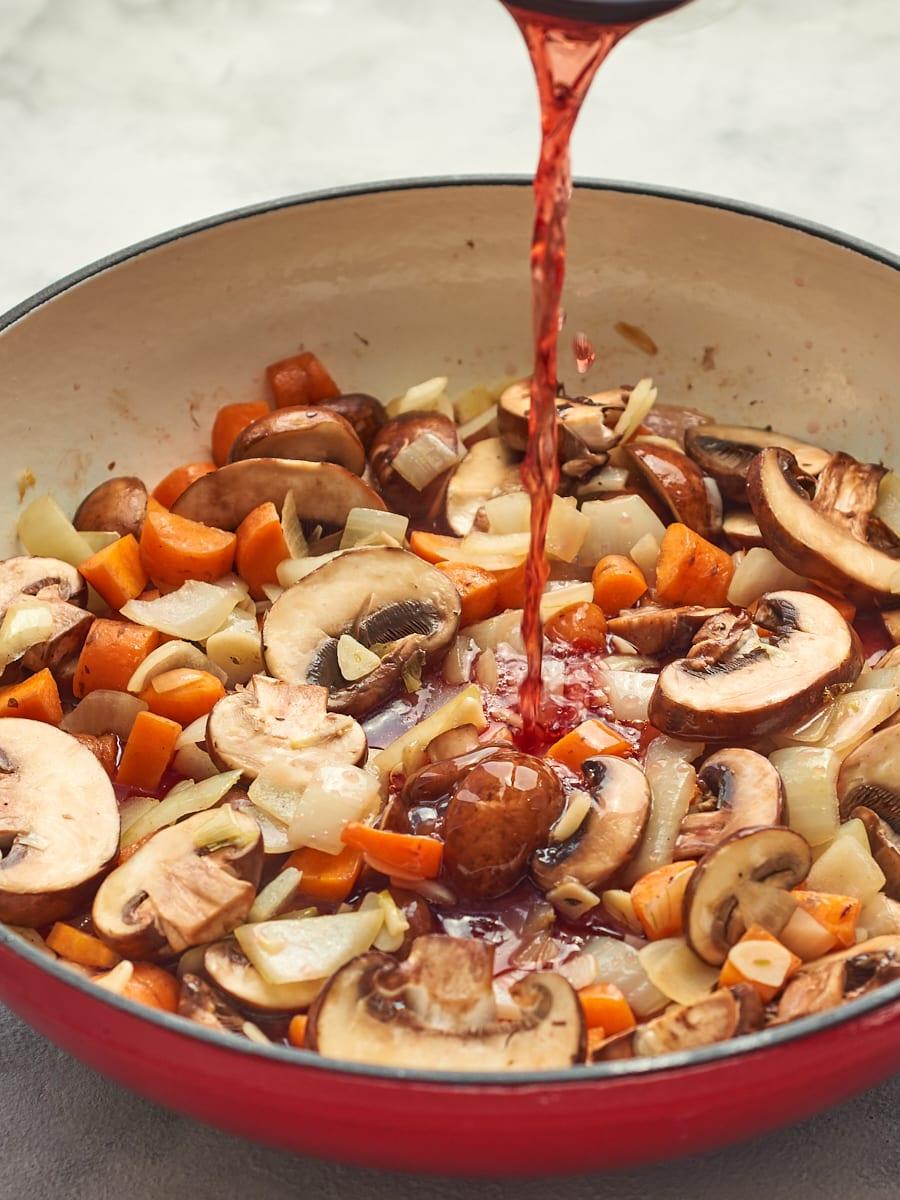 Wine Pouring into Lentil Ragu