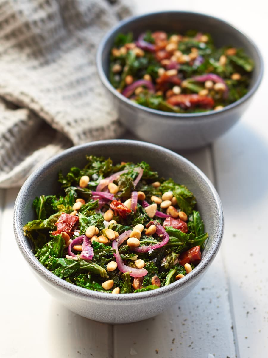 Sauteed Kale with Garlic and Toasted Pine Nuts in bowls