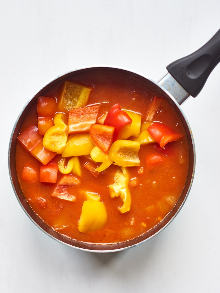 Adding peppers to soup