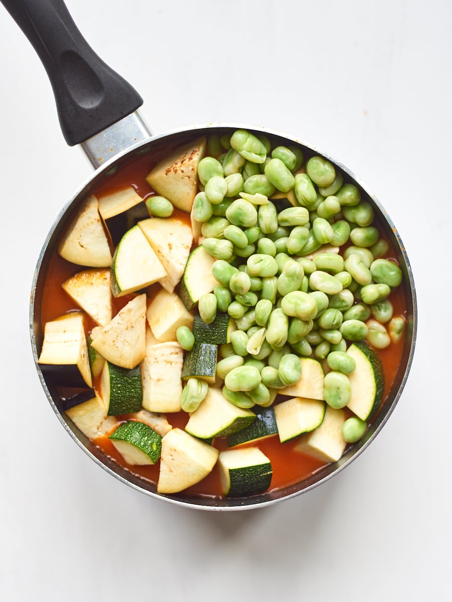 Adding broad beans and courgettes to soup