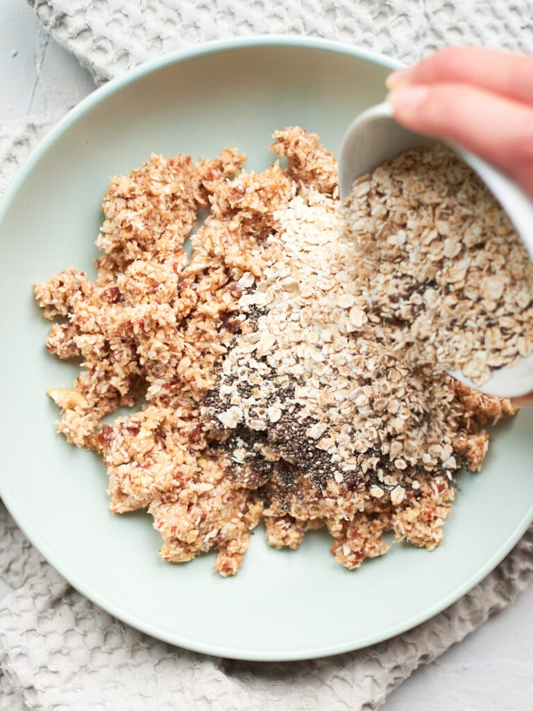 adding oats and chia seeds