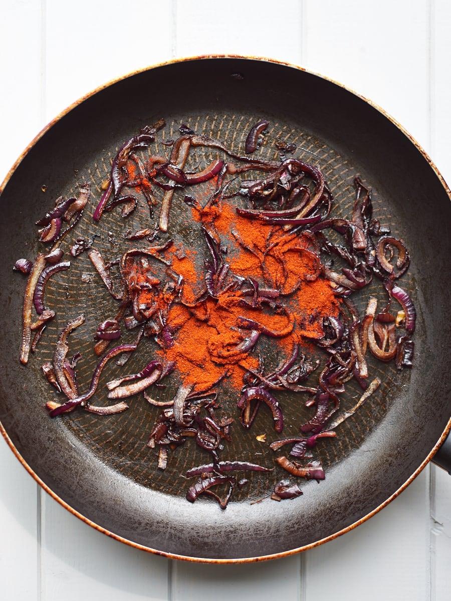 Adding paprika to caramelised onion