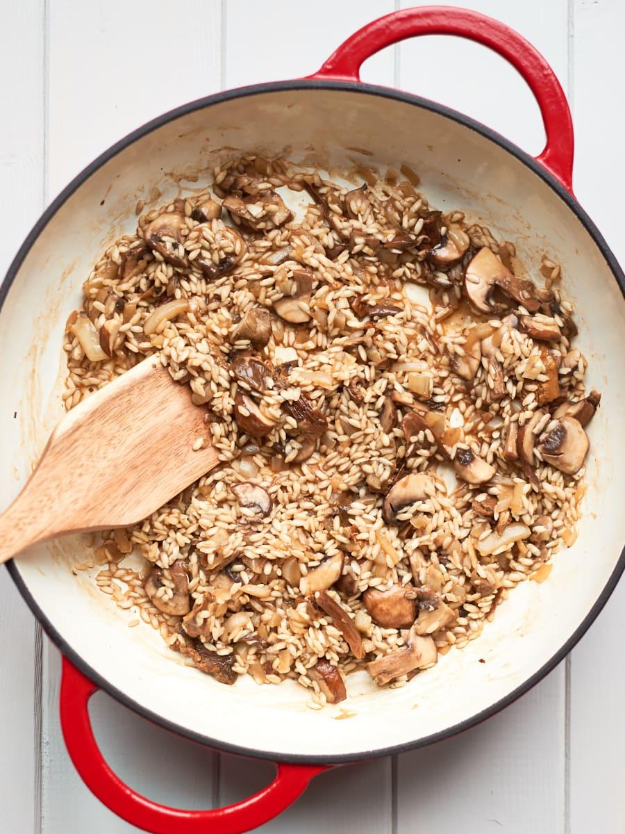 Stirring mushroom risotto 2
