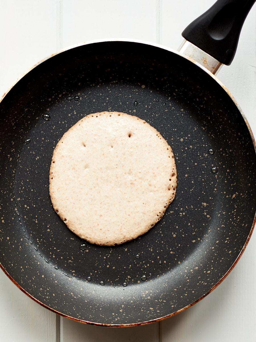 Making banana pancake in pan