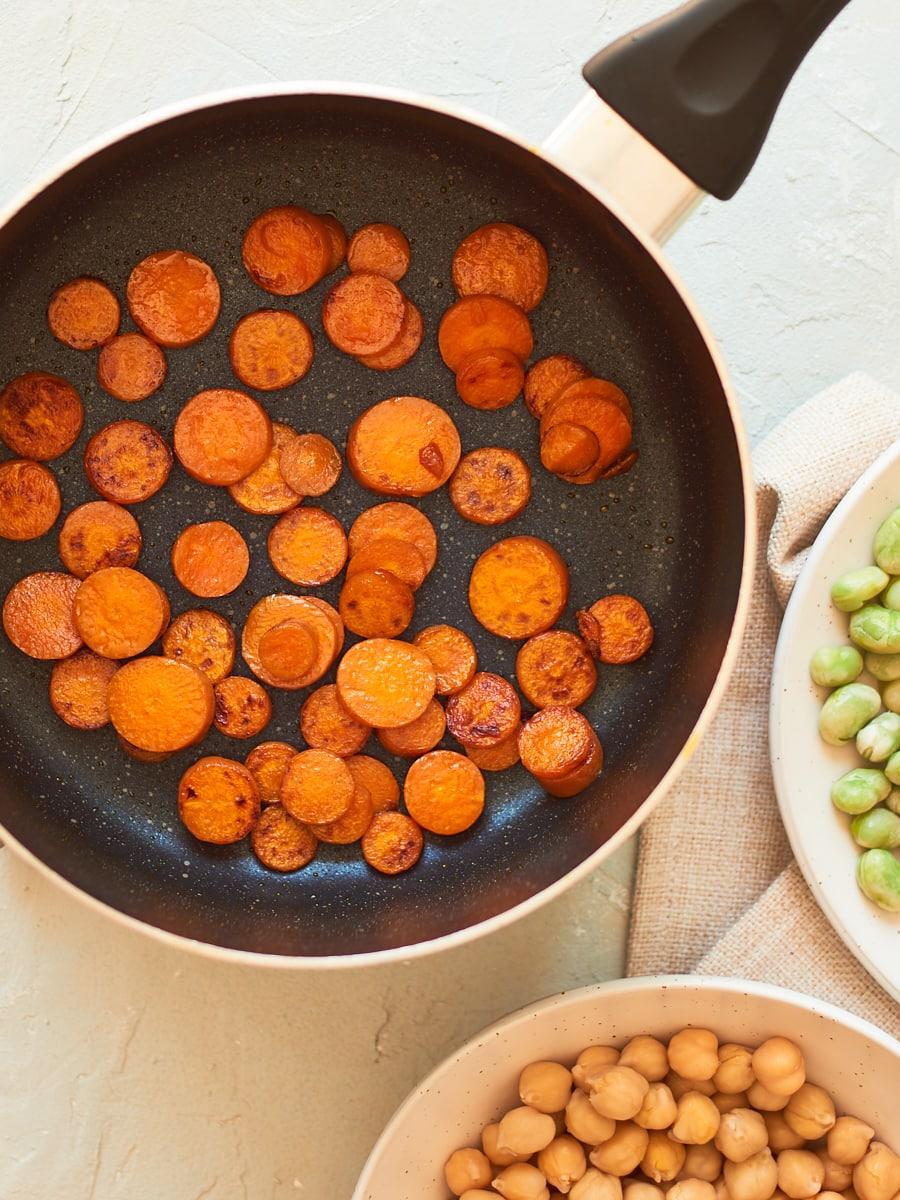 Carrots frying in pan 2