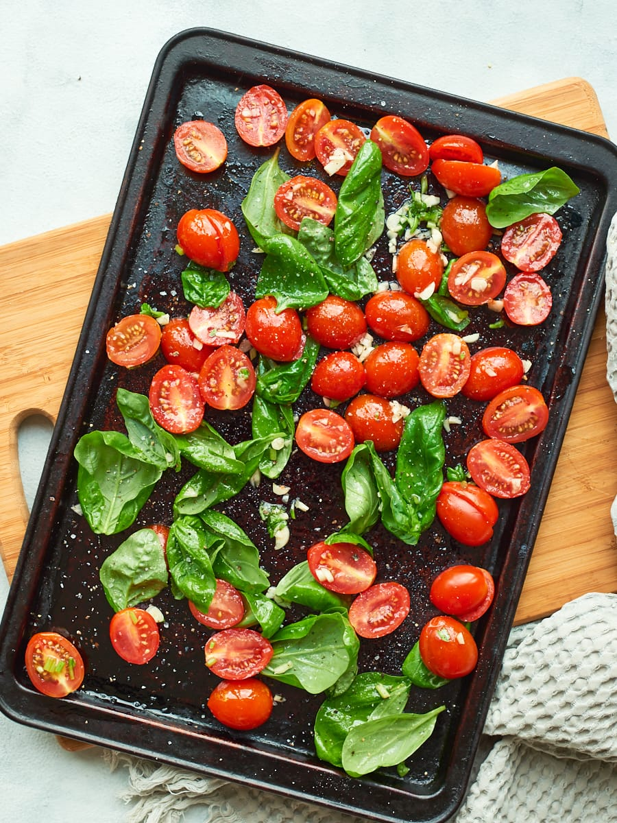Tomatoes, basil and garlic on a tray with oil 2
