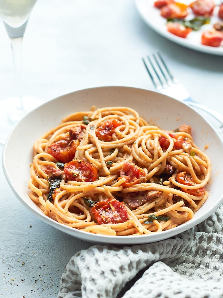 Tomato Spaghetti carbonara in bowl with wine 2