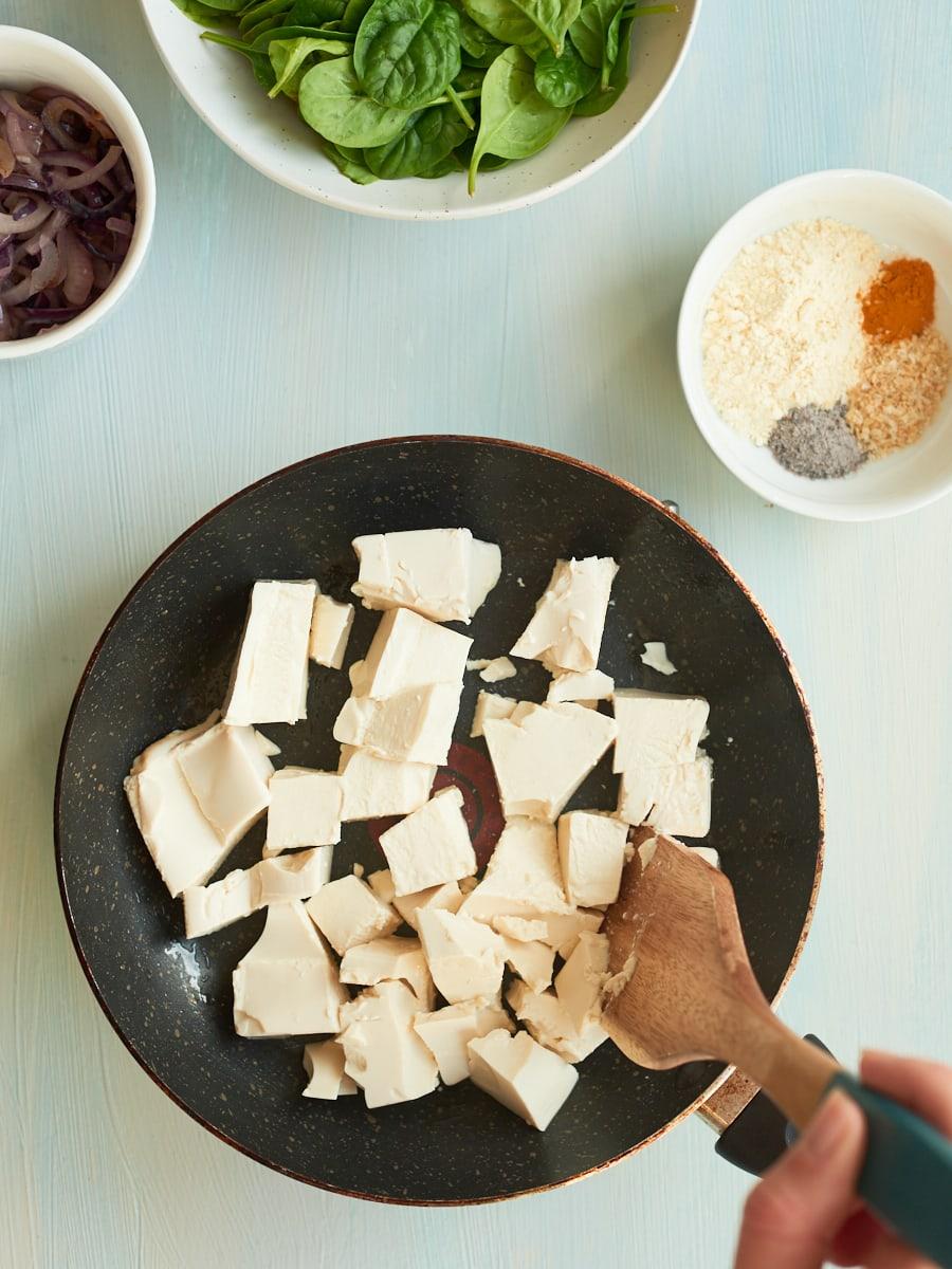 breaking up silken tofu in pan