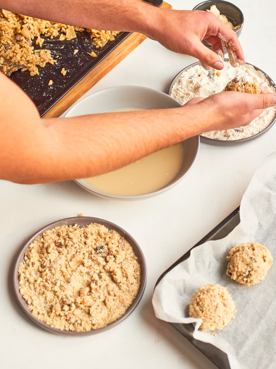 dip risotto ball into flour