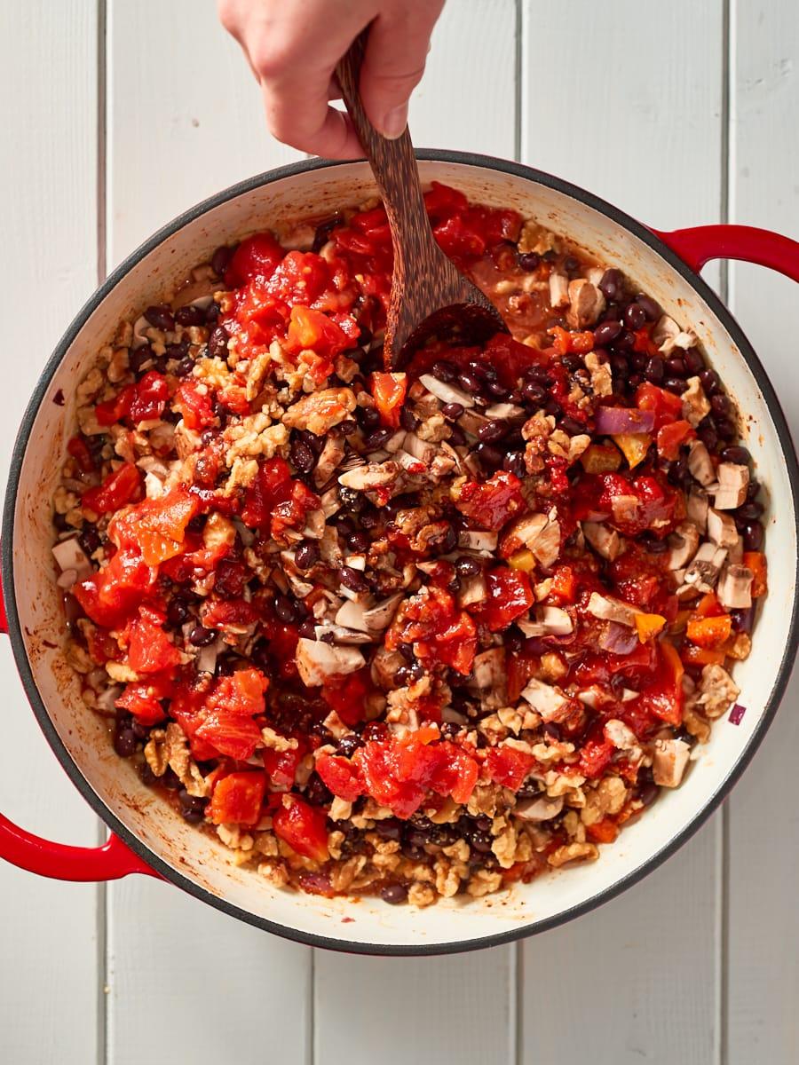 adding remaining ingredients to pot