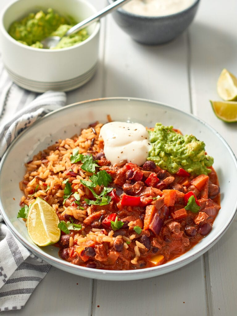 Chilli plates up with rice, guac, and sour cream