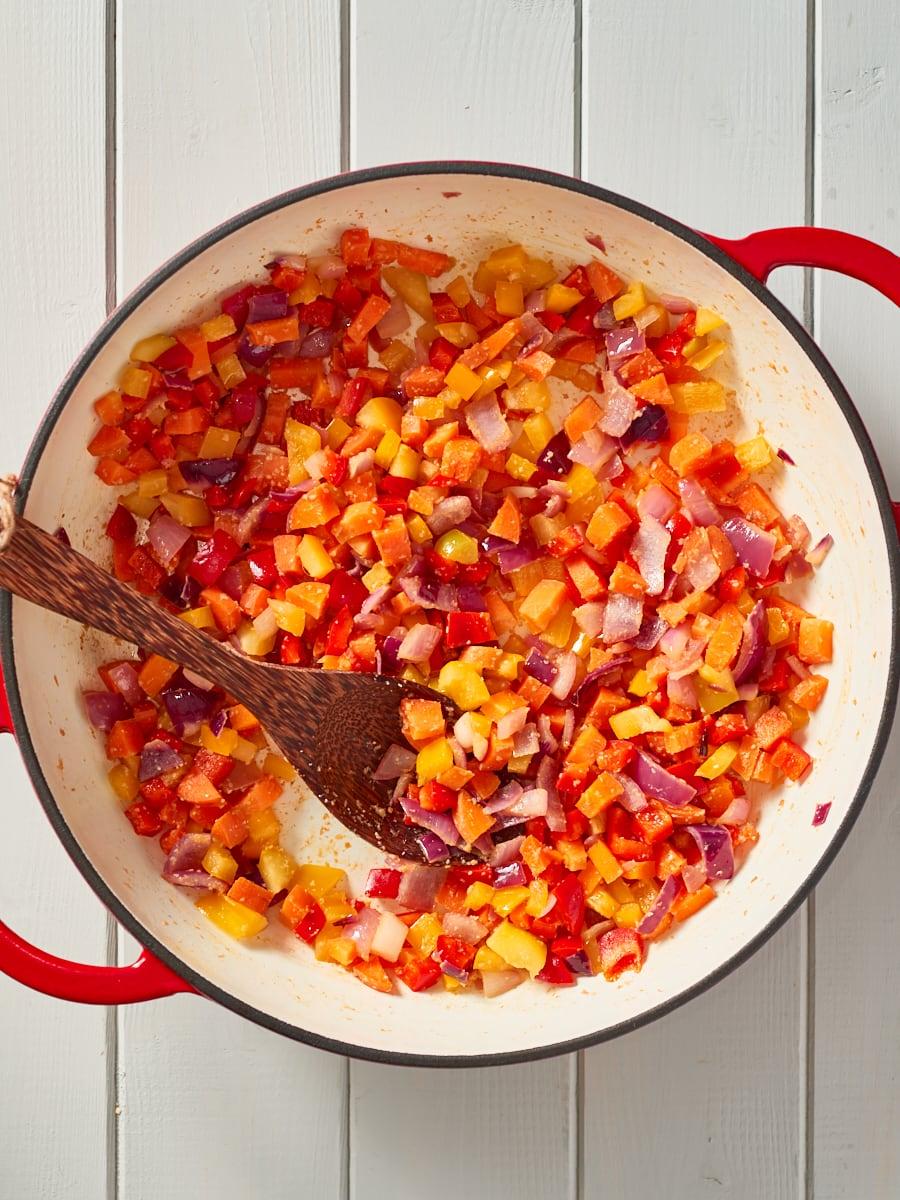 stirring veggies in pan
