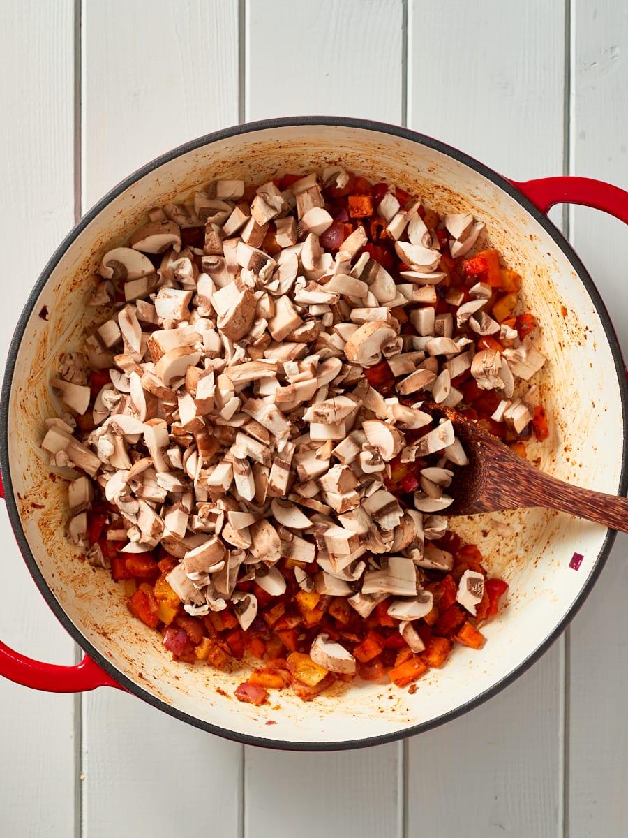 Adding mushrooms to pot with chilli non carne