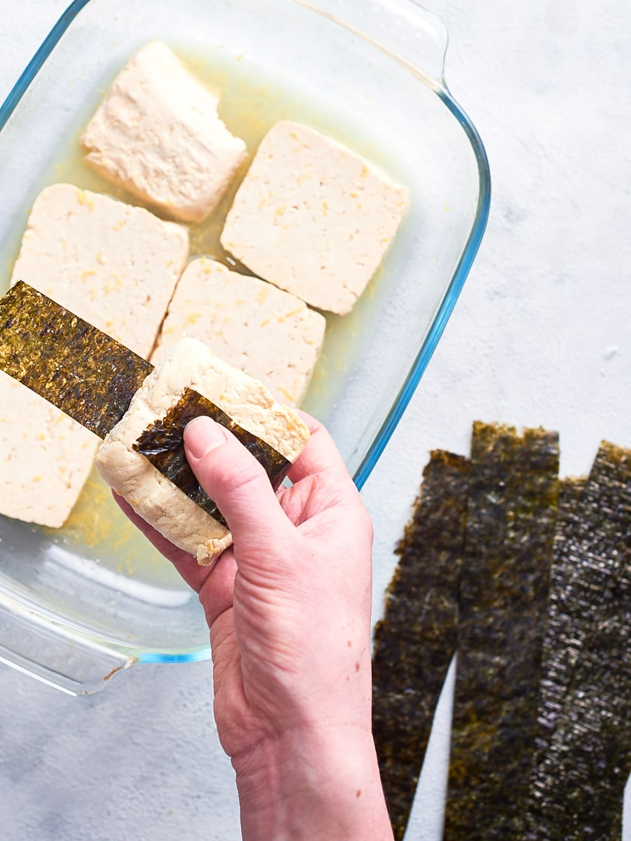 wrapping nori around tofu