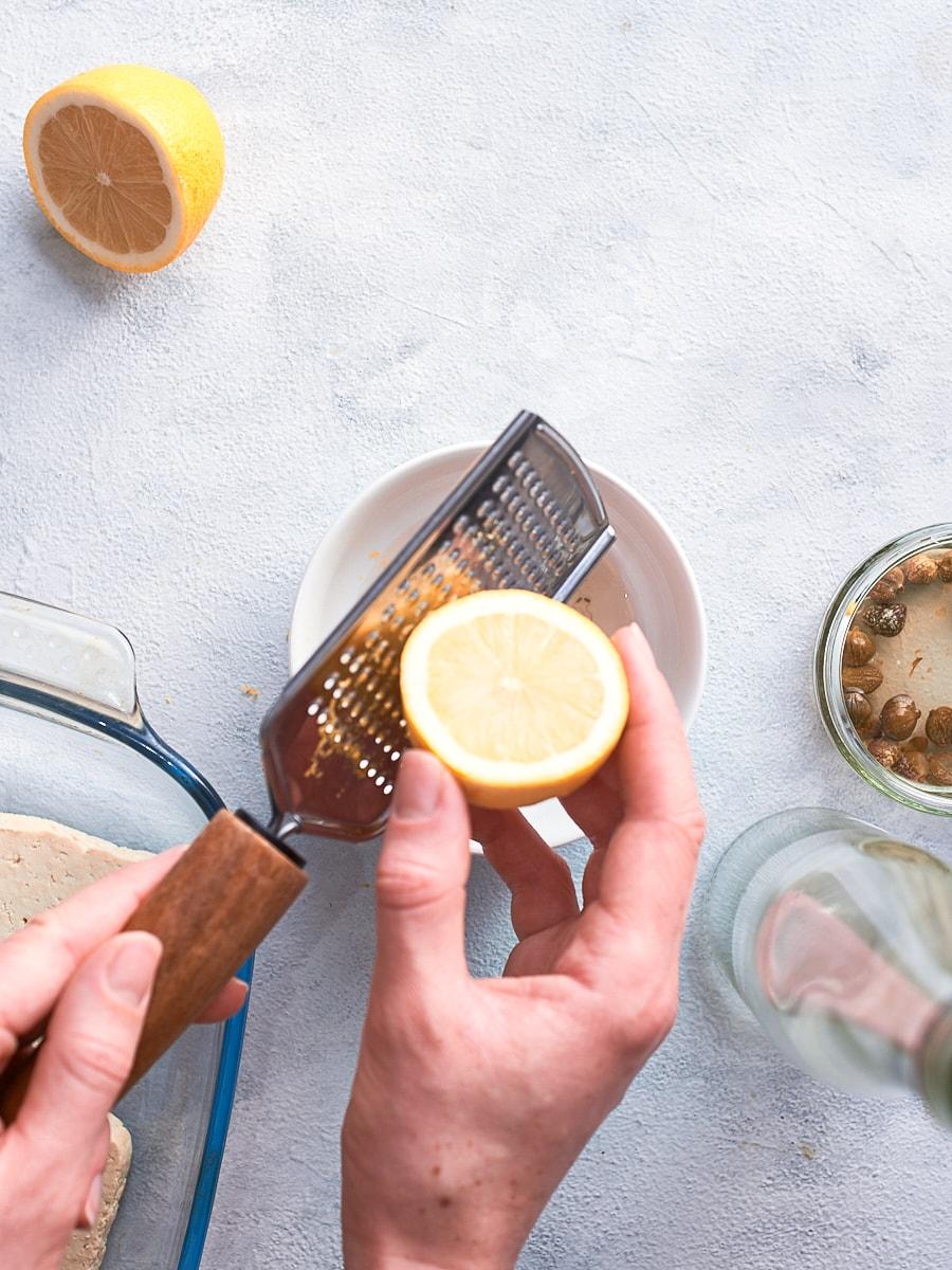 Adding lemon zest to vegan fish marinade