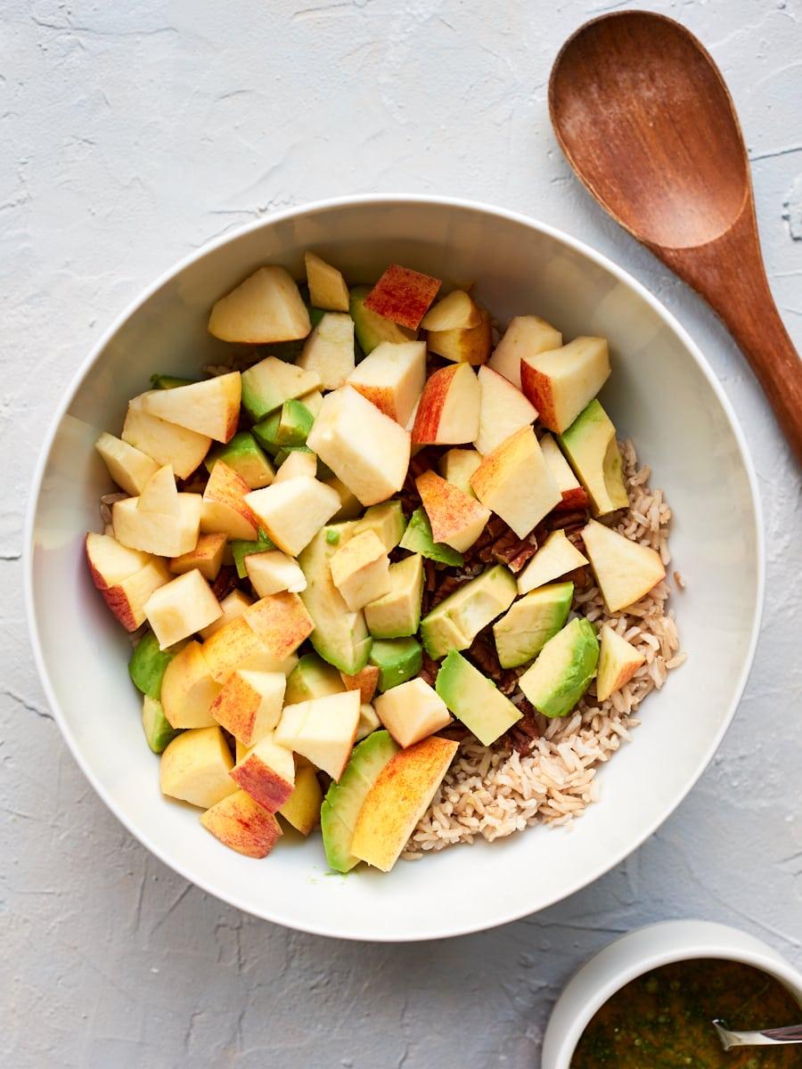 adding apple to mixing bowl