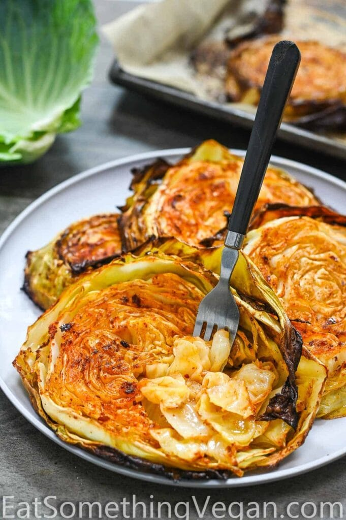 cabbage steaks with fork