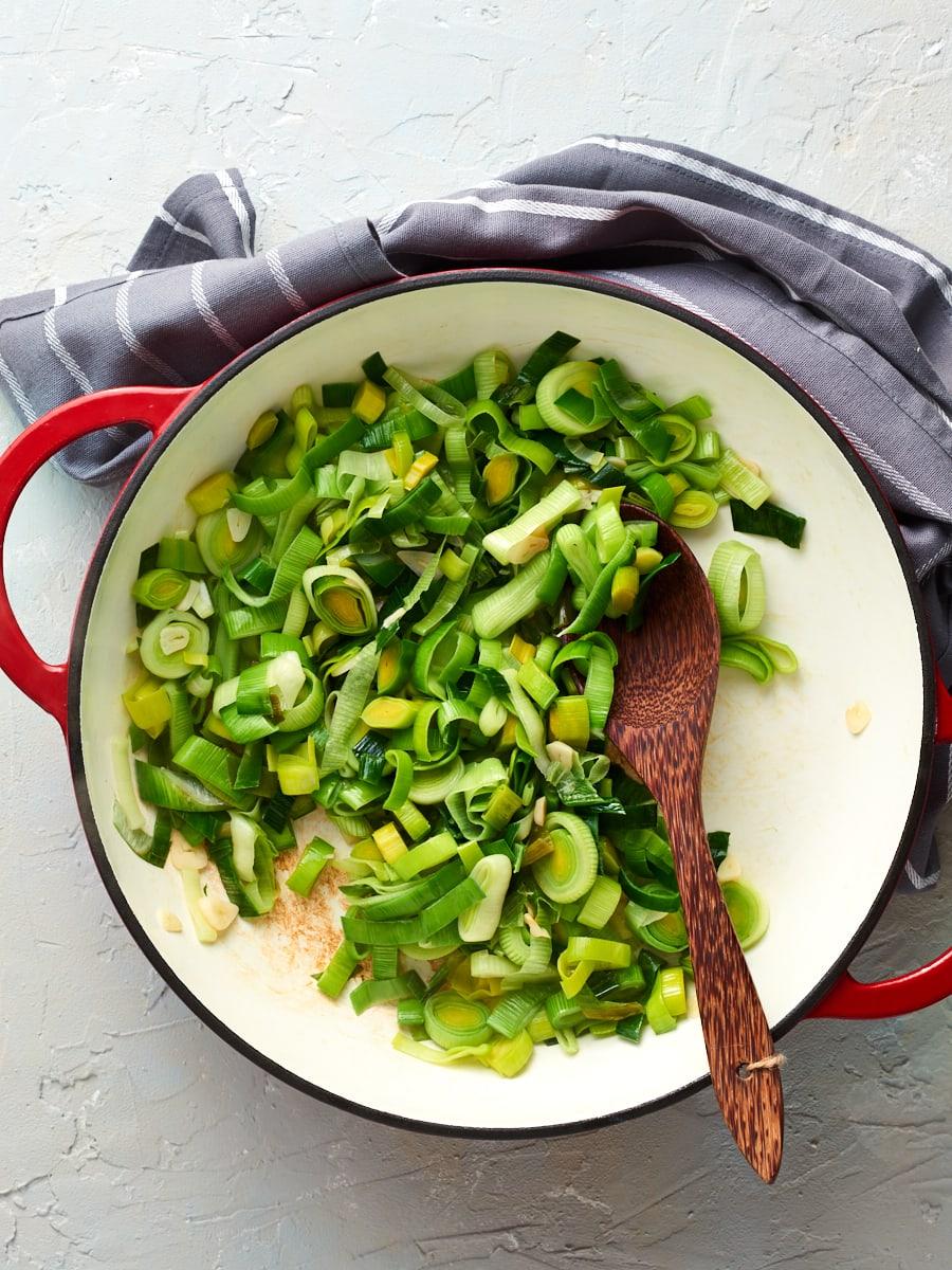 Leek and garlic cooking in pan