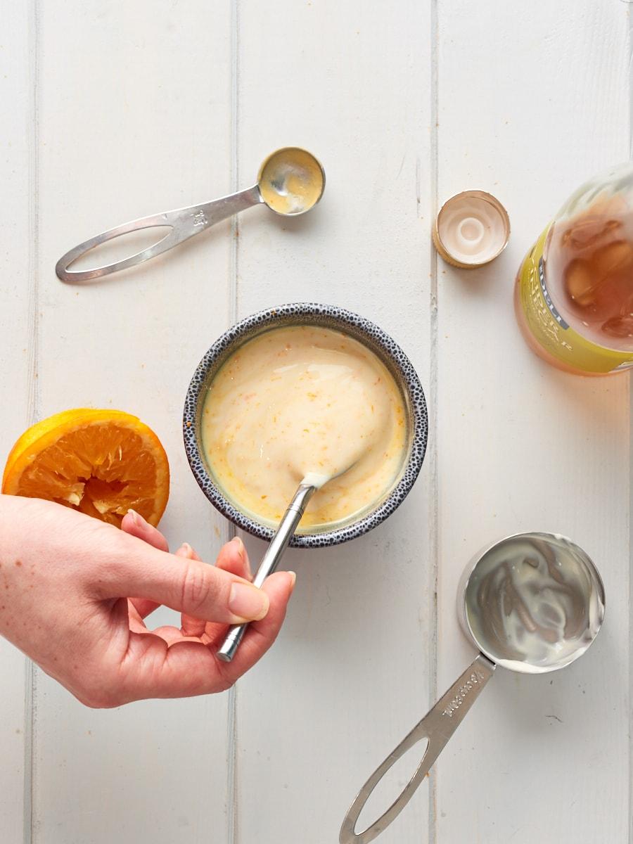 Mixing orange yoghurt dressing