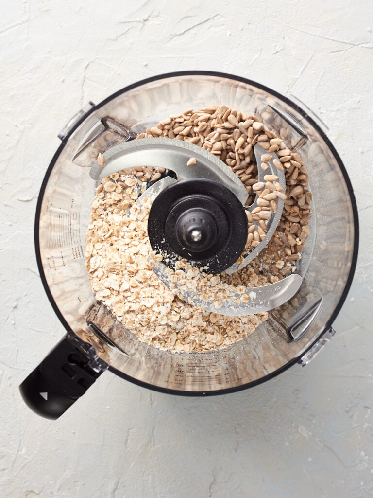 Oats and sunflower seeds in food processor