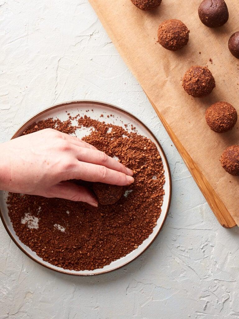 Rolling the dough in peanut cocoa crumb