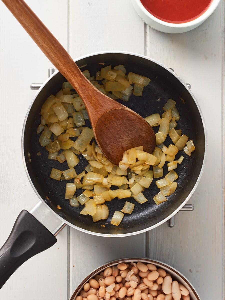 Frying onion in pan