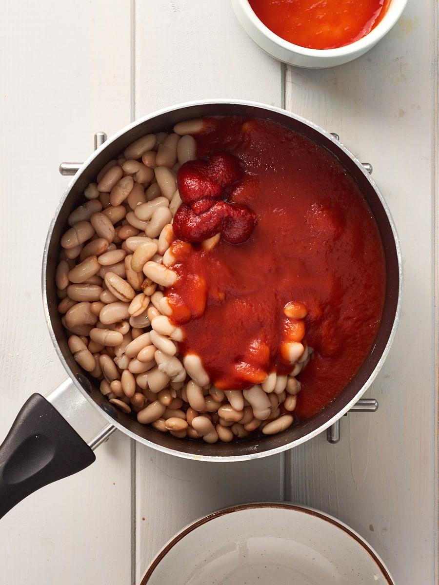 Adding tomato paste to pan