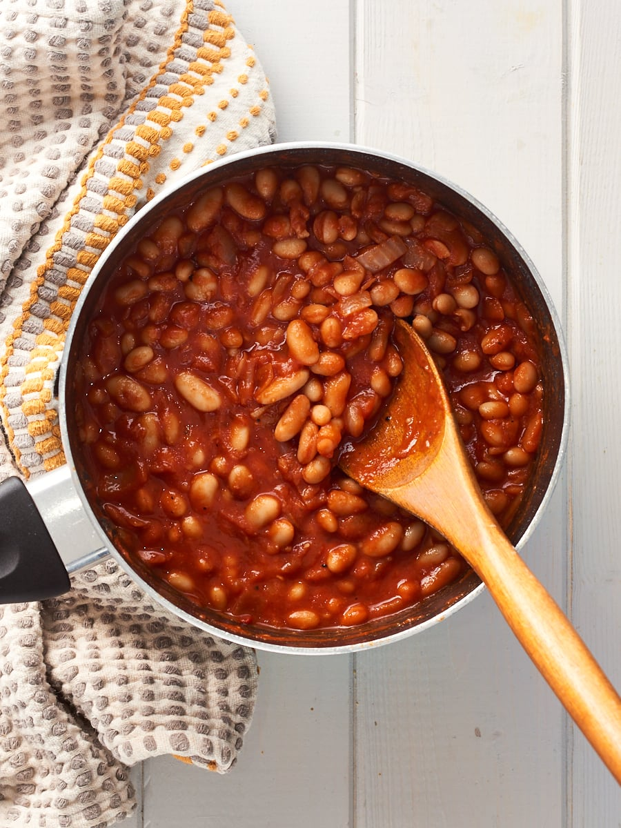 Cooked baked beans in saucepan