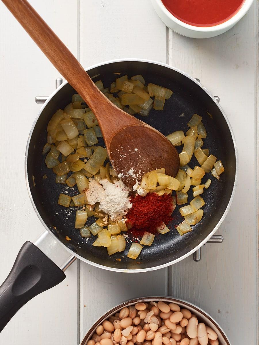 adding paprika and garlic powder to pan