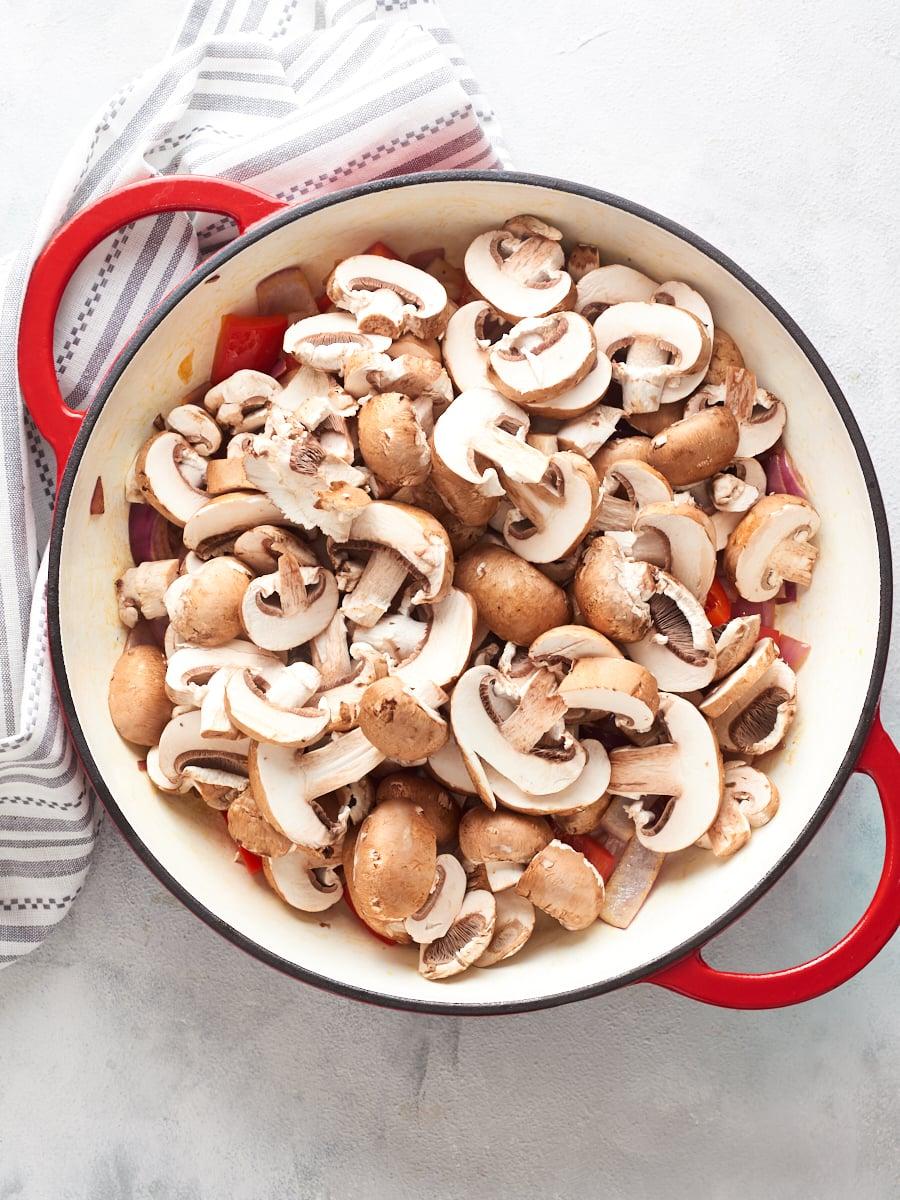 Adding mushrooms to pan