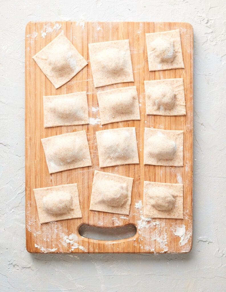 cut up raw ravioli on a board