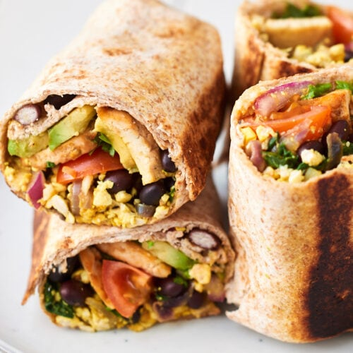 Two breakfast burritos on a plate