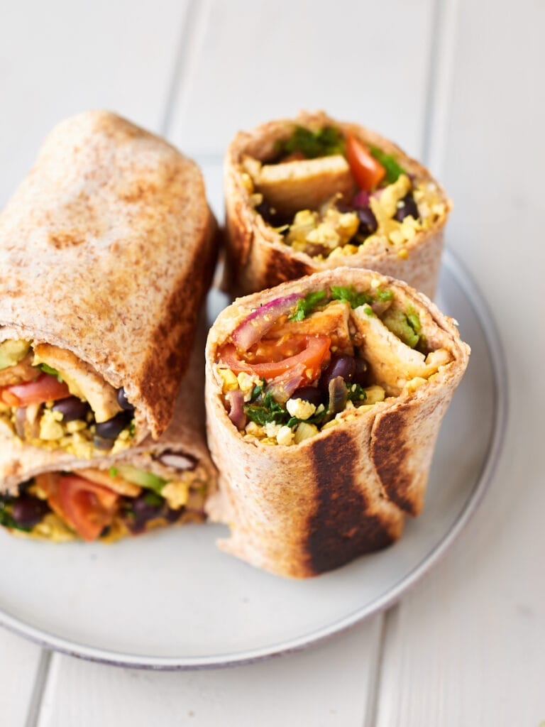 Two breakfast burritos on a plate 2
