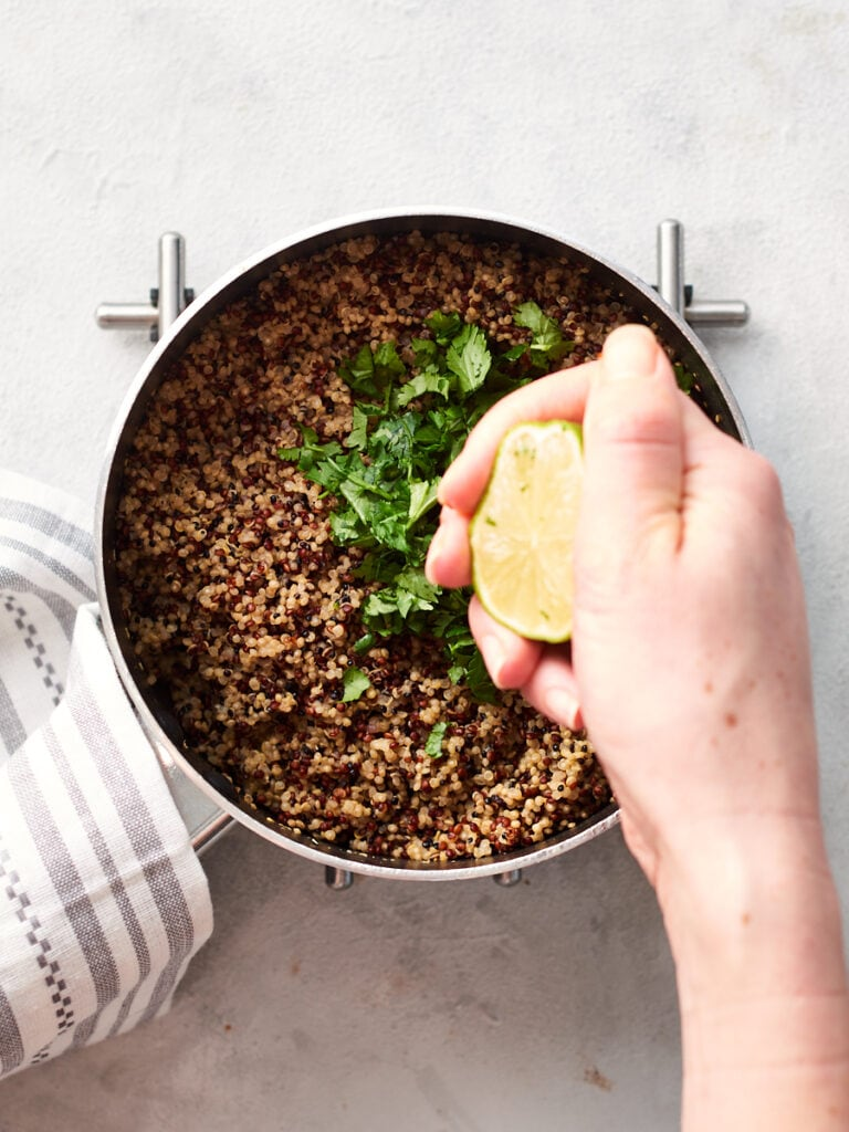 Squeezing lime juice into the quinoa