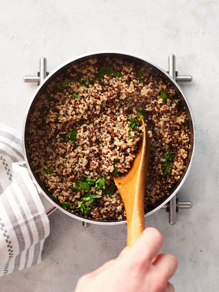 Mixing coriander lime quinoa