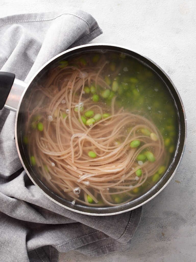 cooking the noodles and edamame