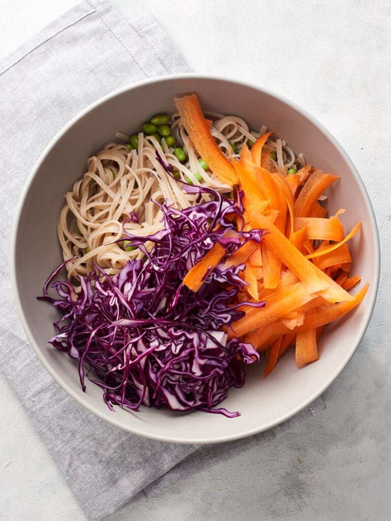 Noodles and vegetables in a large bowl