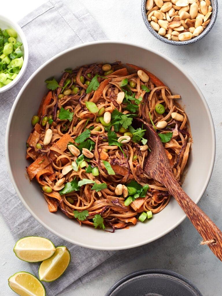 Vegan peanut noodles in large serving bowl