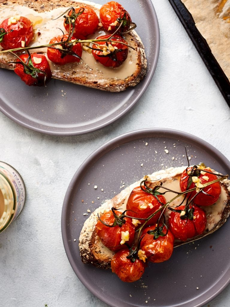 Tahini and tomatoes on toast on two plates