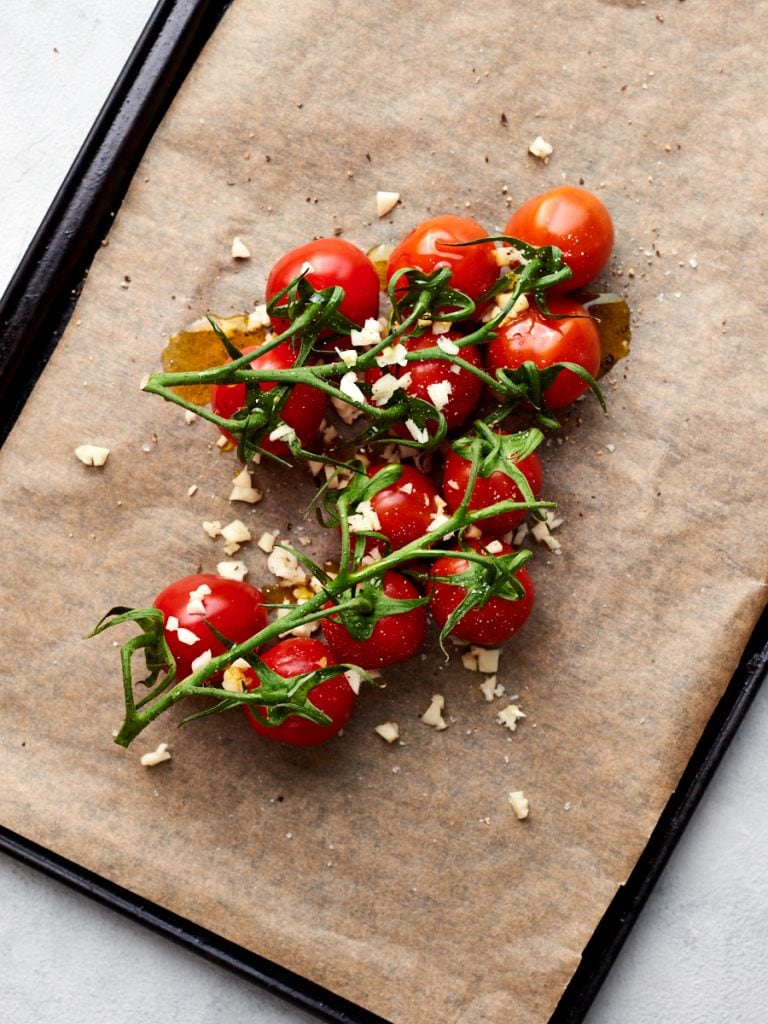 Roasting tomatoes and garlic on tray