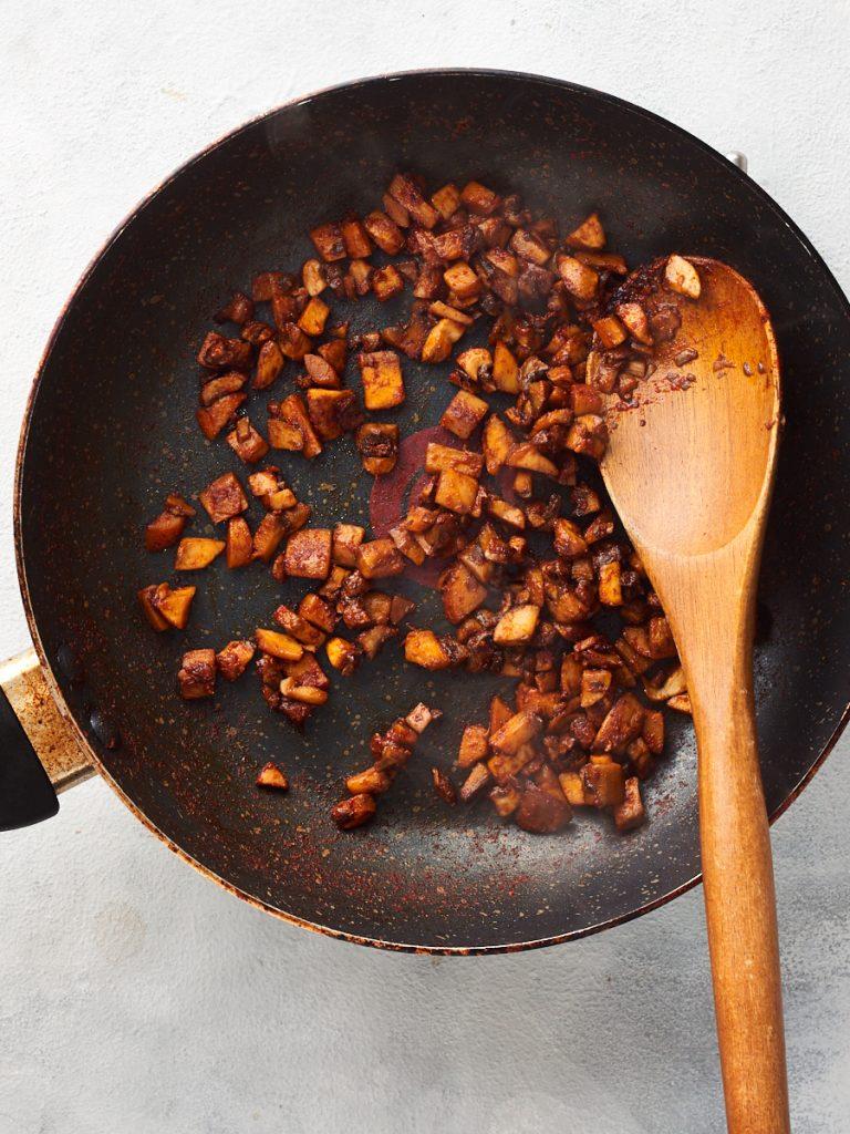 Frying mushrooms unitl dry