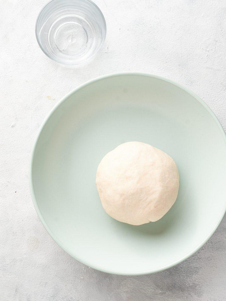 Smooth ball of vegan pierogi dough