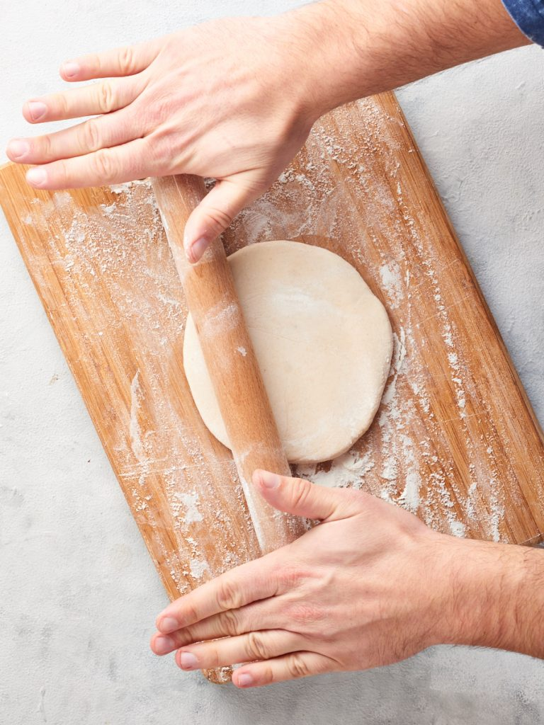 Rolling out dough for pierogi