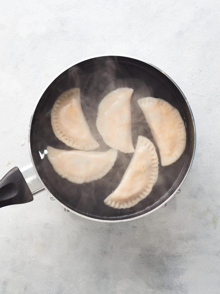 Boiling the pierogi in a pan