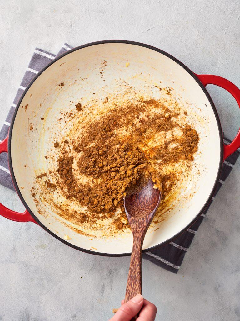 Adding the biryani spices to the garlic
