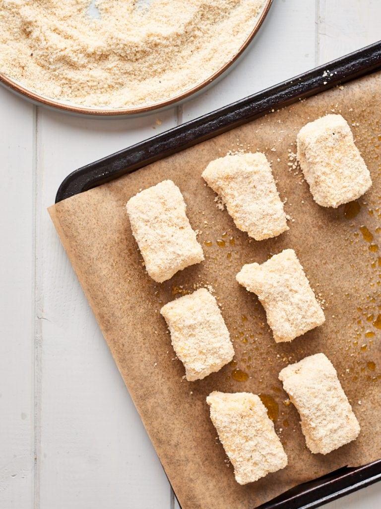 Coated tofu nuggets on a baking sheet raw