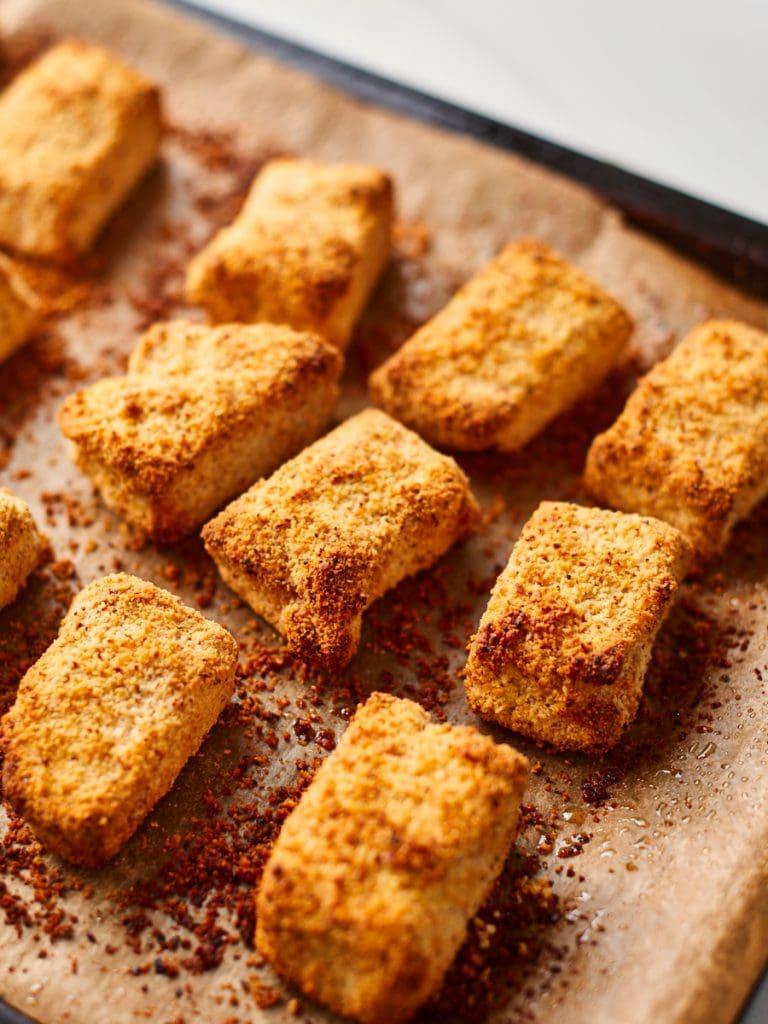 Golden crispy baked vegan chicken nuggets on baking sheet