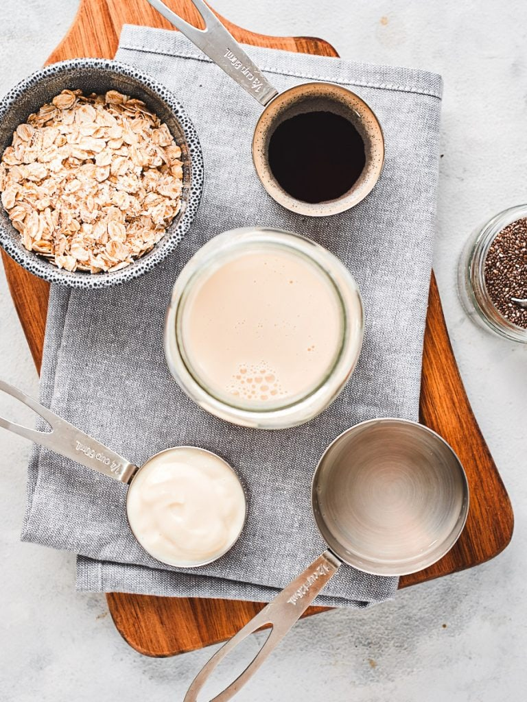 Adding milk to mason jar for coffee overnight oats