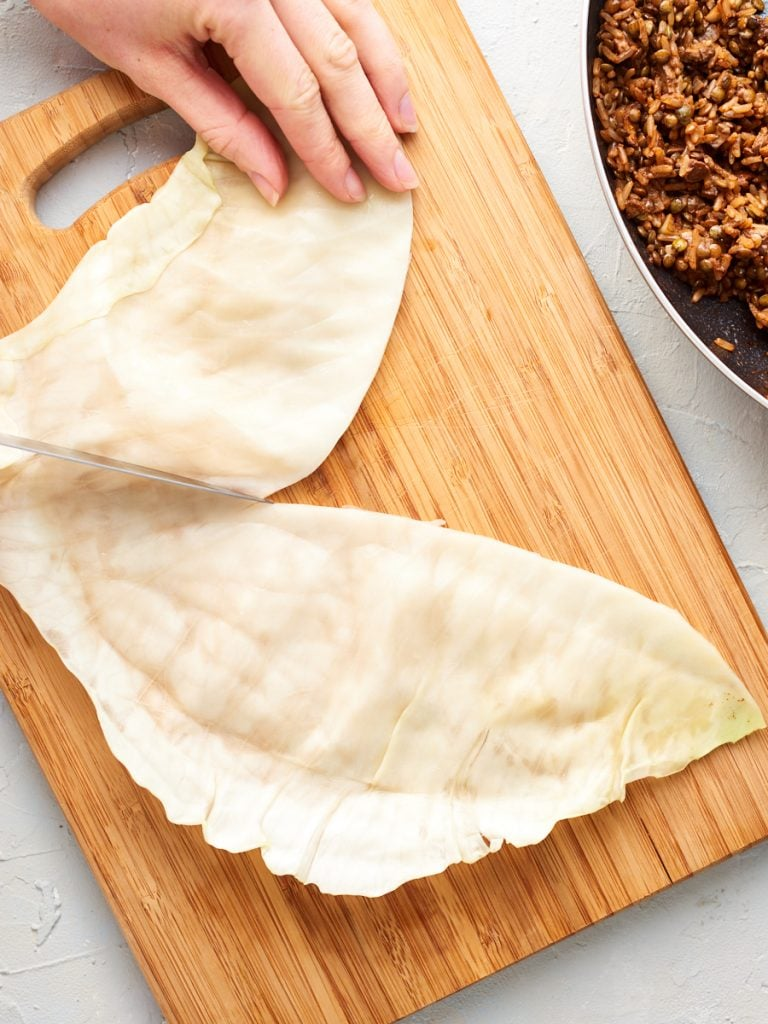 Slicing a cabbage leaf into 3